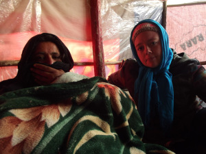 Janey interviews a mother in a refugee camp