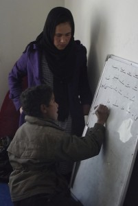 APV Zarghuna teaching street kids, photo by Maya Evans